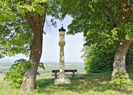 column with statue of the abandoned Mother of God on the way to the weather cross above of Hollenburg on the Schiffberg at the Danube valley, Austria