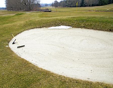 golf course with fresh raked sand hazard at the region Burgenland in spring, Austria Фото со стока
