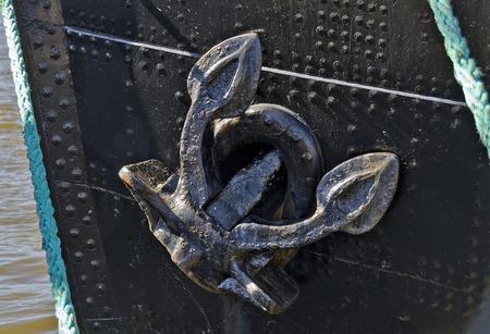 old anchor at the bow of a riveted hulk of an old iron ship at Hamburg, Germany Stok Fotoğraf