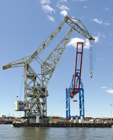 floating crane and container gantry crane at the harbour of Hamburg, Germany