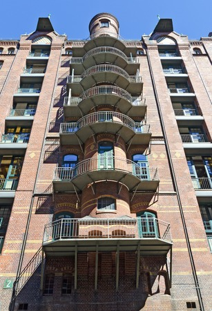 apartment building with balconies and traditional clinker facade at the socalled