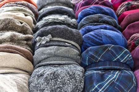 caps and beanies at a stall in the open on occasion of the traditional Simoni market at Tulln, Austria Stock Photo
