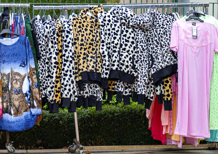 clothes hanging on a rack in the open on occasion of the traditional Simoni market at Tulln, Austria