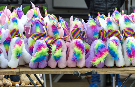colorful stuffed animals on a table of a stall in the open on occasion  of the traditional Simoni market at Tulln, Austria