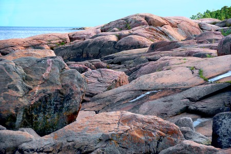 rocky coast of pink granite on the Baltic sea near the city of Oskarshamn in Sweden