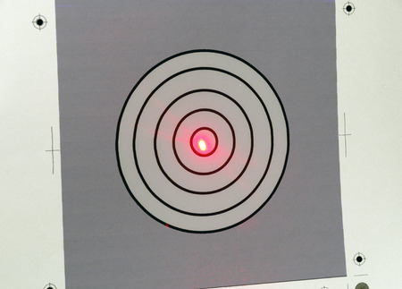 printed target with the red point of a laser beam at the center