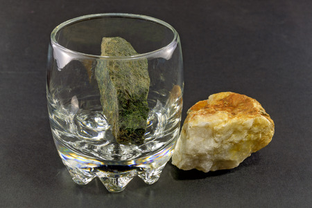 still-life made from a tumbler glass to drink Whisky and small rocks
