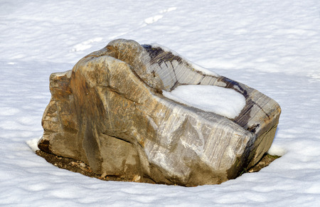 a big rock fragment on a snowcovered area 免版税图像