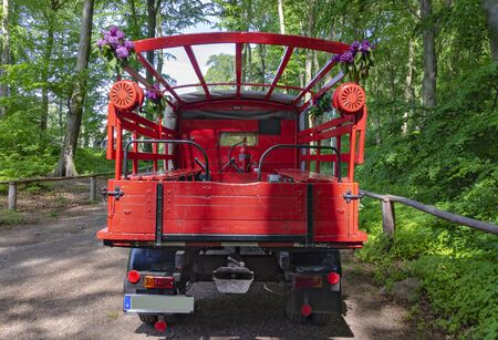 decorated old red fire brigade vehicle in the forest near Sassnitz, Germany