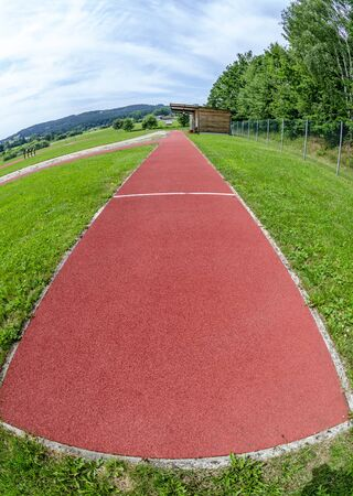 red all-weather synthetic track of a sports facility at Harbach, Austria