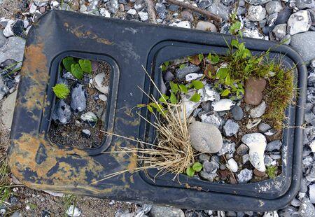 Suspended load of scrap on a pebble beach on the Baltic Sea on Ruegen, Germany Banco de Imagens