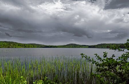 Thundery atmosphere above the lake Gissen at Sweden Reklamní fotografie