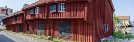 Historic falun red wooden storehouses (Loftbodarna) at Västervik, Sweden Reklamní fotografie