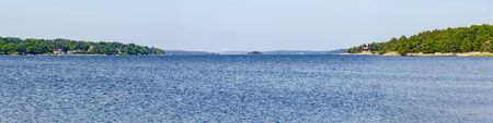 view across the blue Baltic sea until the horizon to the archipelago of Västervik, Sweden