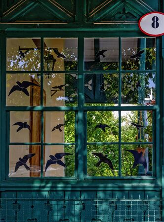 wooden  patio with black symbols of birds for protection on the windows Reklamní fotografie