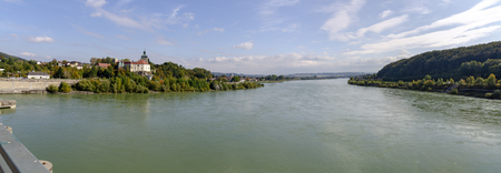 panoramic view of the river Danube downstream of the hydroelectric power plant Ybbs-Persenbeug with the palace of Persenbeug on the left riverside, Austria