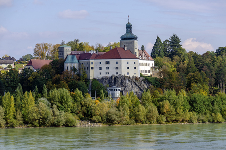 palace Persenbeug above the river Danube and the lockhouse of the hydroelectric power plant of Ybbs-Persenbeug, Austria