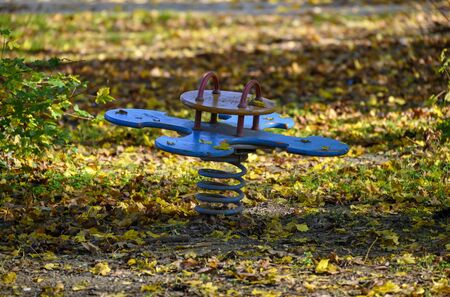 playing device on a  childrens playground with autumnally foliage Stock Photo