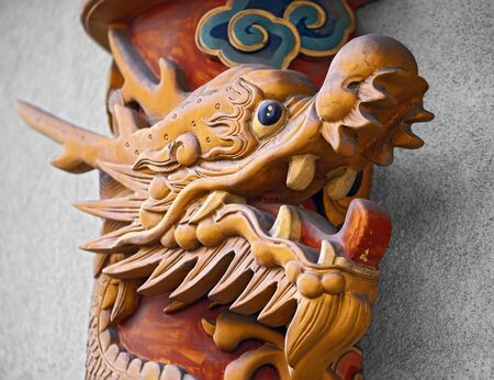 sculpture of a monster shaped like a fish as decoration at a chinese restaurant