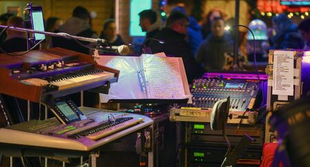 Electronic music devices, mixer console and effects units installed for the performance of  a band at a christmas market in the city of Tulln, Austria