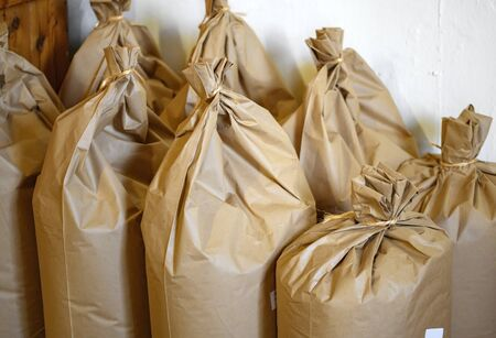 brown paper bags filled with wheat meal in a grain mill