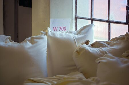 wheat flour of the type 700 in white fabric bags in a grain mill
