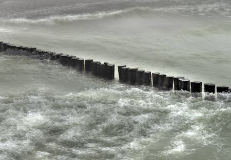waves along a wooden breakwater at the Baltic sea, Germany