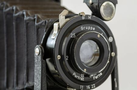 an old optic on a  historic bellows camera