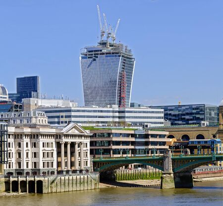 city of London on the river Thames at Southwark Bridge and the Walkie Talkie Tower under construction in the background, England, Great Britain Stock Photo