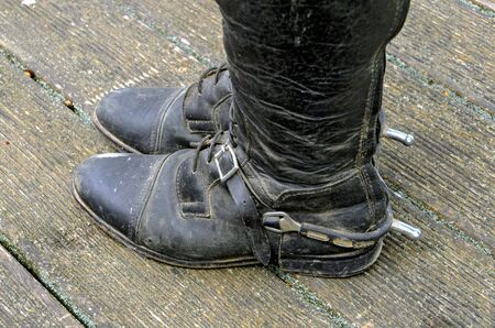old black riding boots made from leather with buckled spurs with short blunt ends