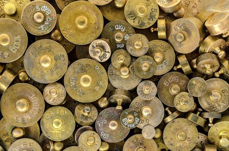 punchmarked brass weights with different weights from 100 to 5 gram