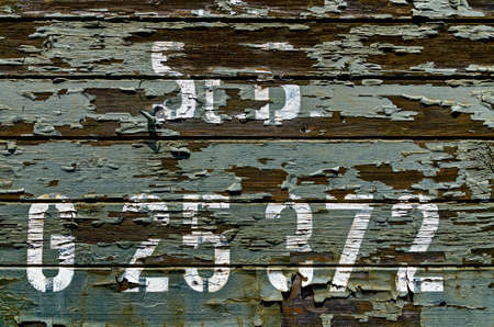 weather-beaten wooden walling of a former waggon of the kk austrian state railways with white inscription, Austria
