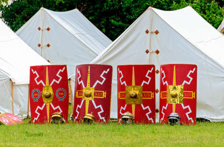 camp of the 13th legion with white tents, shields and helmets at an event in the roman town of Carnuntum, Austria