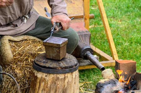 work on a roman battlefield forge during reenactment festival at Carnuntum, Austria Standard-Bild