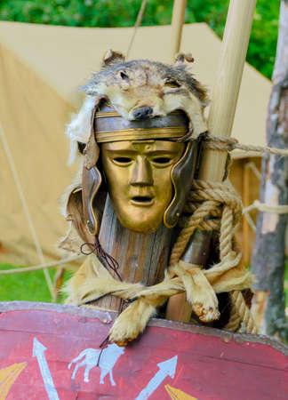 wolfskin on a helmet and a golden maks of a roman legionnaire at Carnuntum, Austria