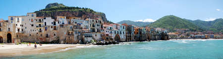 panoramic view of the historic town of Cefalu on Sicilia from the seaside, Italy Imagens