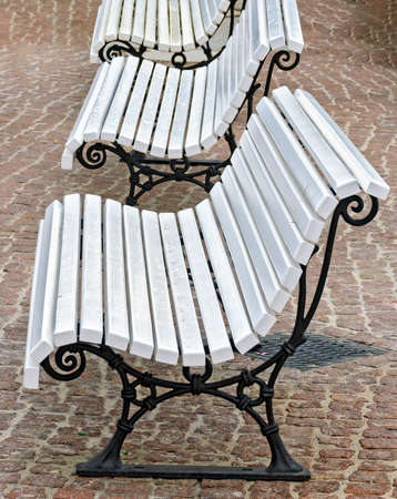 park benches with a frame of black painted cast iron and a white wooden seating surface at Binz, Germany Standard-Bild
