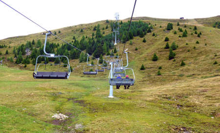 Quad chair lift above a ski slope on the so called Zettersfeld above the town of Lienz in summer, Austria