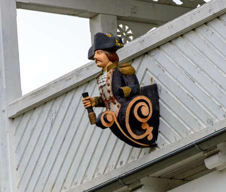 figure in uniform of a captain as house mark in the spa village Binz on he Baltic sea, Germany Standard-Bild