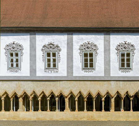 Inner yard of the former Friars Minor Conventual monastery with cloister and window front at Krems, Austria
