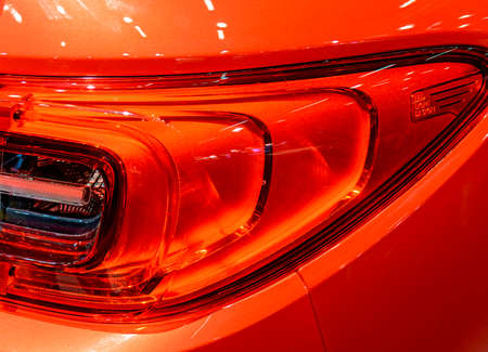 glossy orange red car body with LED headlight Standard-Bild