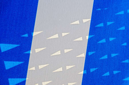 blue and white colored plastic with embossing of textile pattern