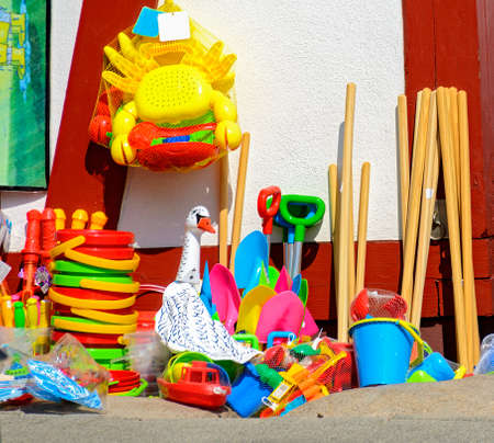 colorful toys made from plastic for children on the beach
