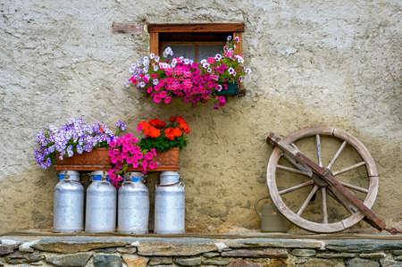 rural decoration on a rough plastered facade of a farmhouse Standard-Bild