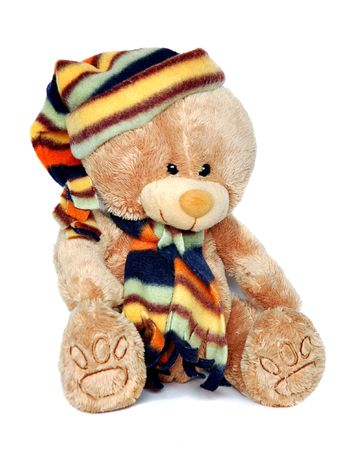 Teddy bear with cap and scarf photo