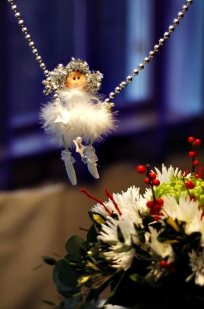 Dangling christmas angel and flower Stock Photo - 5790163