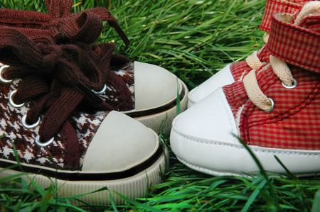 Two childrens shoes in the grass