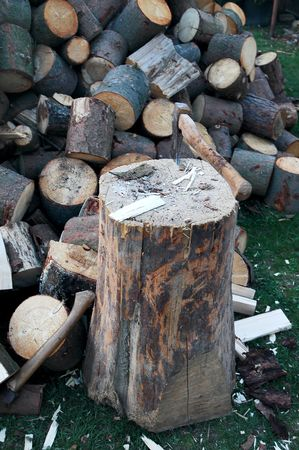 Log on cleaving wood and ax photo