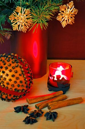 Orange with cloves, candle, cinnamon and star anise photo