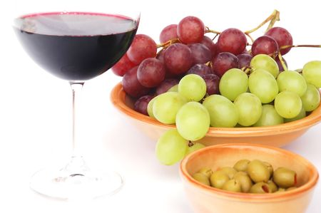 Red wine, olives and grapes